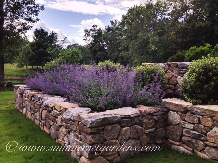 Superb Garden Design: A Rustic Country Stone Retaining Wall And Plantings Ideas