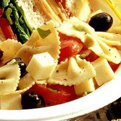 Italian dressing and mozzarella cheese are combined with pasta in this simple to make pasta salad.