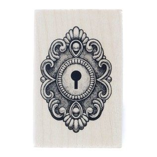 """Give your projects and crafts an added dose of inspiration and creativity with this Ornate Lock Rubber Stamp. Featuring a design etched in pink rubber and set against a wooden block, this stamp is fun and easy to use. Use any color ink pad (sold separately) for personalized creations. Dimensions: Wooden Block: Length: 2 1/2"""" Width: 1 9/16"""" Depth: 3/4"""" Rubber Shape: Length: 2 1/8"""" Width: 1 1/2"""""""
