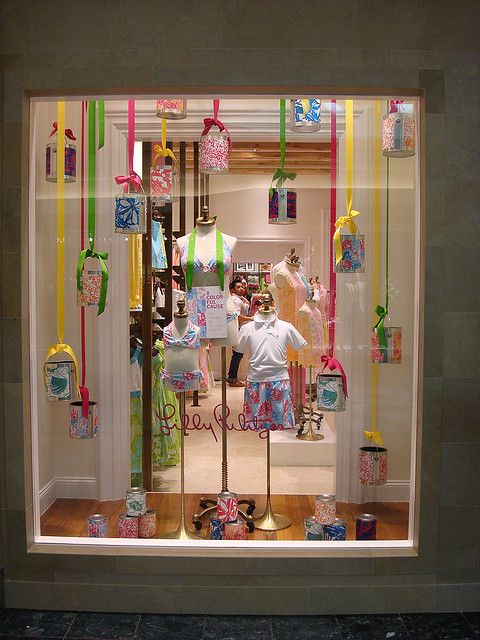 Lilly Pulitzer window display - hanging paint cans with colourful ribbons. #retail #merchandising #windowdisplay #hanging #repurpose