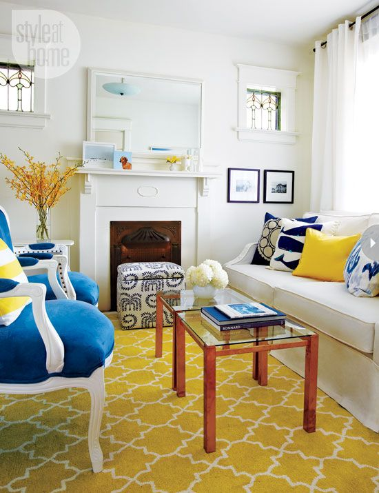 With such a small space, avoiding clutter was key, so Jen and Luke scaled back on all the hand-me-down pieces they had and removed the stuff that they didn't absolutely love. The blue and white lidded ottoman doubles as storage for toys and books. The fresh palette of blue, yellow and white runs throughout the house.