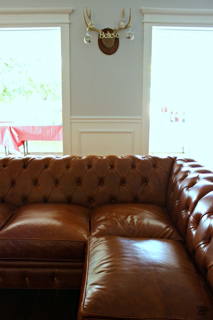 Our New Leather Chesterfield Sectional Sofa! [Even though I like what they're used for, I would minus the antlers...cute re-purpose]