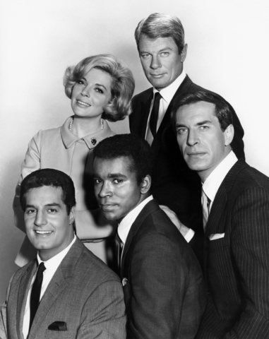 """Peter Graves as Jim Phelps, Barbara Bain as Cinnamon Carter, Martin Landau as Rollin Hand, Greg Morris as Barney Collier, and Peter Lupus as Willy Armitage in the original """"Mission: Impossible""""."""