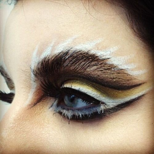 cosmeticevolution: Fierce. Cool, I like how the feathered eyebrows are incorporated into the design.