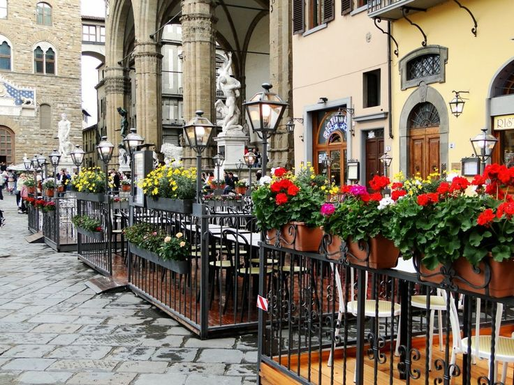 Piazza outdoor cafe in Italy, by Christina Bell