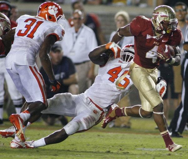 Florida State running back Chris Thompson (4) sheds Clemson linebacker Jonathan Willard (46) during the third quarter. (AP Photo/Phil Sears)