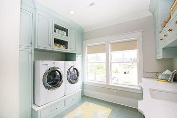 These laundry room cabinets are Palladian Blue by Benjamin Moore.  (The wall color is Silver Sage by Restoration Hardware - looks much more muted next to the Palladian Blue, doesn't it?)