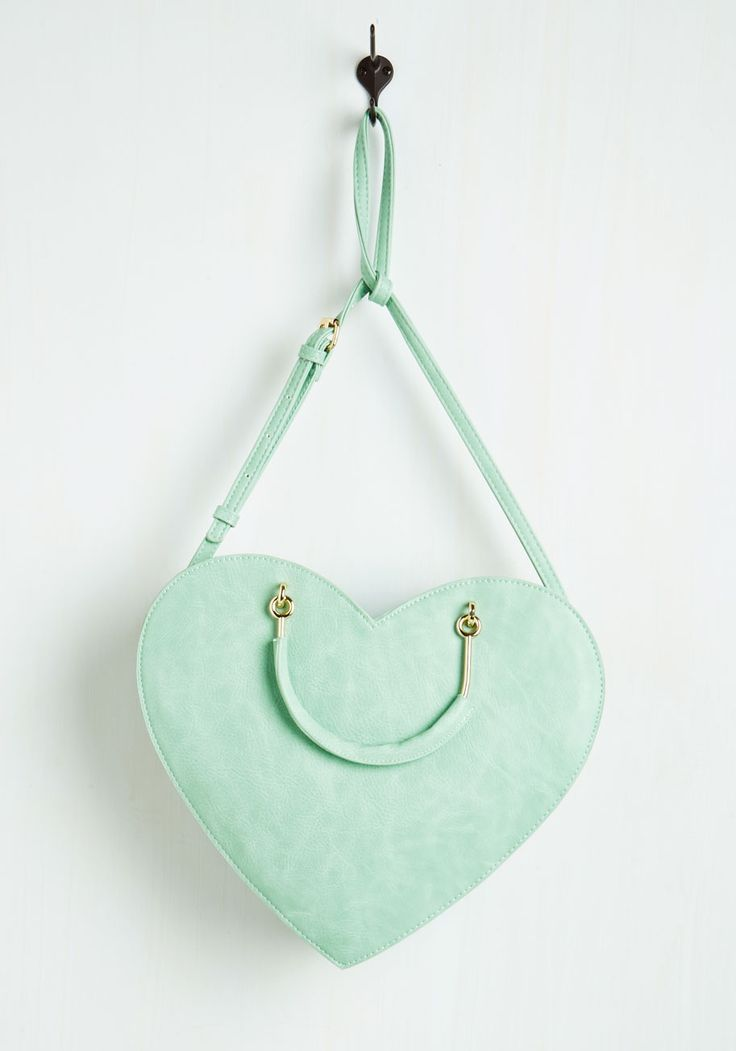 Adorably Affectionate Bag. Wear your heart on your sleeve - literally - when you slide the removable strap of this marvelous mint purse over your shoulder! #mint #modcloth