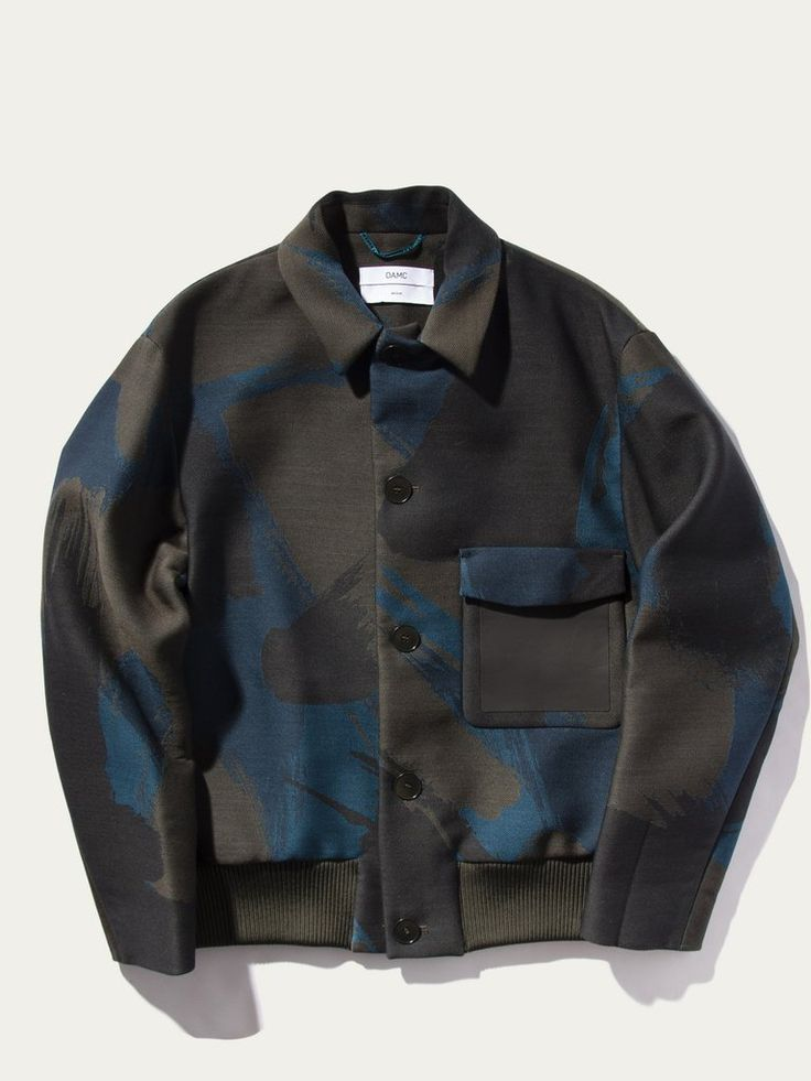black with a blue luster Jacquard Blouson jacket top.