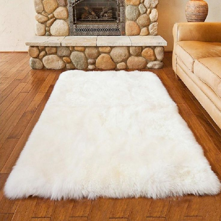 Vegan Sheepskin Rug. Perfect for any room with a black and gold color scheme.