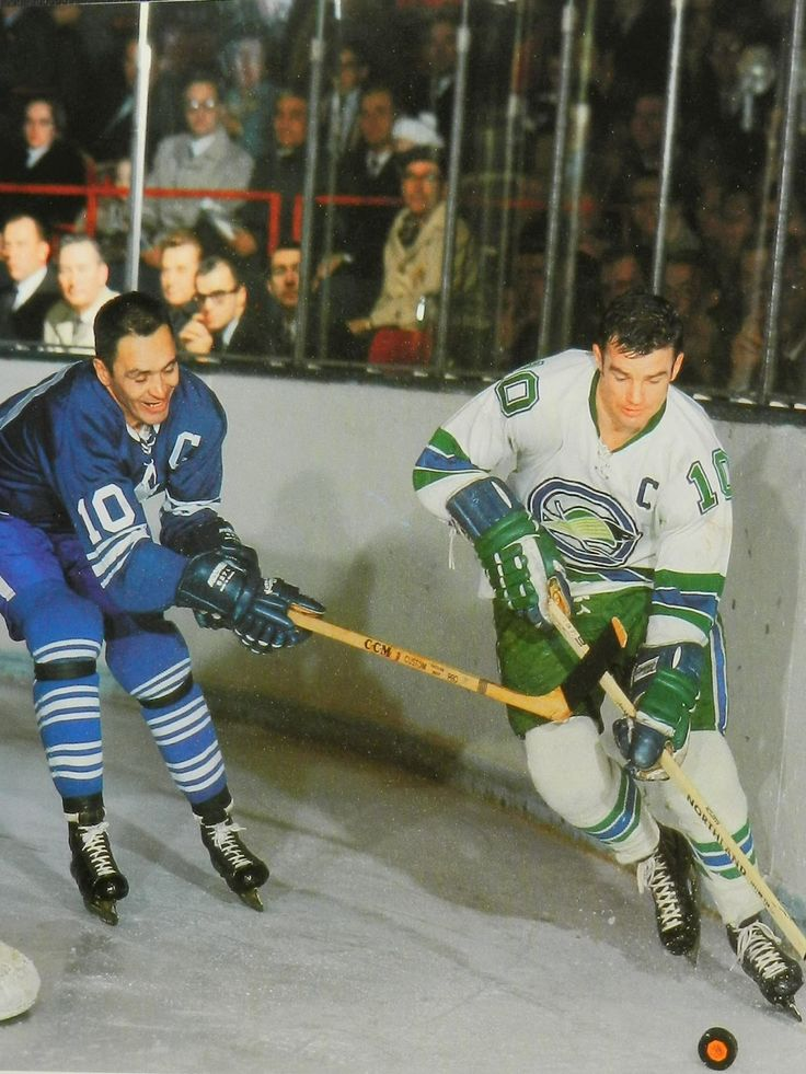 -snip- GEORGE ARMSTRONG CHASES FORWARD TED HAMPSON OF THE OAKLAND SEALS IN 1968 GAME AT MAPLE LEAF GARDENS.