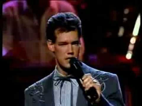 Randy Travis - Forever And Ever, Amen.  Thanks to those who like the video. This was the song that we heard everyday of our honeymoon...kinda one of our songs.