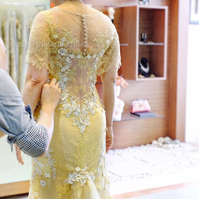 """Fitting  #RuslyTjohnardi #RuslyTjohnardiAtelier #lace #tulle #couture #highfashion #style #elegant #embroidery #beautifuldress  #crystals #bride #yellowdress #swarovski #hautecouture  #flowery #amazingdress #handmade"" Photo taken by @ruslytjohnardiatelier on Instagram"