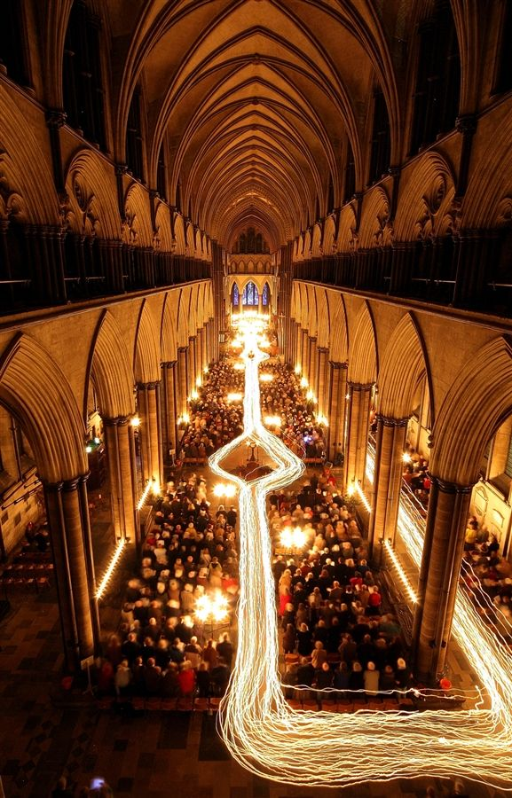The interior of Salisbury Cathedral is illuminated by trails of candles carried by choristers during the annual 'darkness to light' advent procession on Nov. 25, in Salisbury, England.