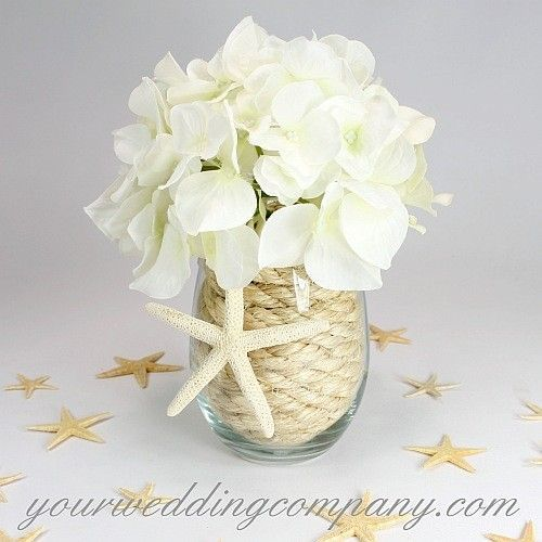 This Diy Beach Themed Wedding Centerpiece Is Made By Coiling Natural Sisal Rope Inside A Beach Wedding Centerpieces Wedding Centerpieces Diy Beach Centerpieces