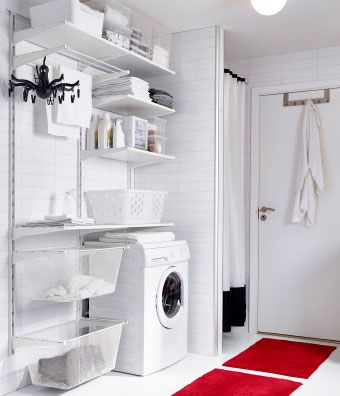 Ikea /A utility room with white wall shelves, boxes in different sizes and a drying rack