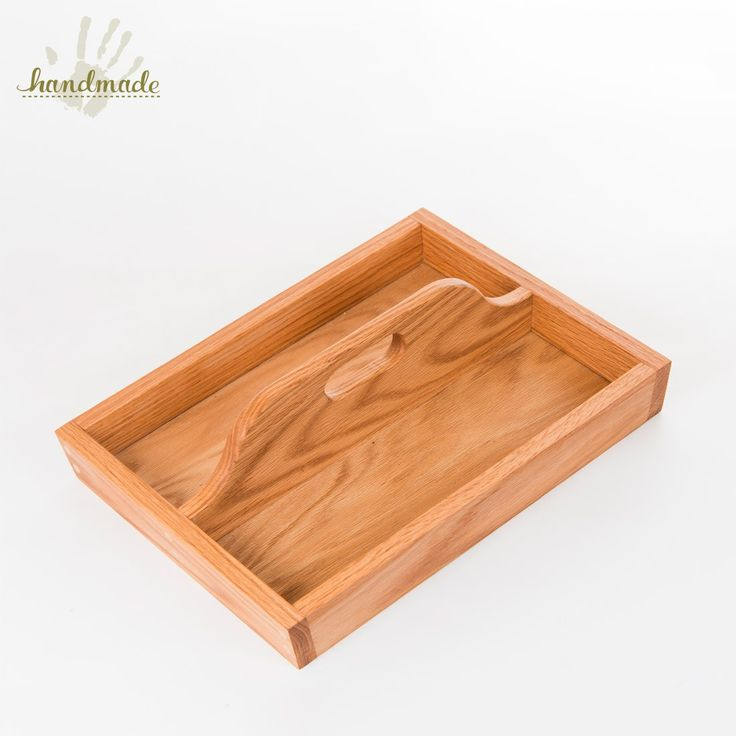 This hand-crafted wooden tray can also be used as a caddy and is the perfect tabletop accessory to combine form and function. Use it on a dresser for loose change or at a picnic for condiments - the uses are endless. Craftsman Anthony Glass with South Alabama Woodworks used oak to create this impeccably crafted piece. Measures 14.5