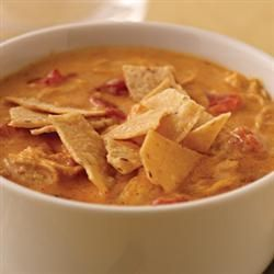 Cheesy Tortilla Soup Allrecipes.com  Approx. 130 calories per serving minus the chicken.  Looks yummy!
