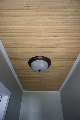 Bamboo paneling to disguise a ceiling imperfection!
