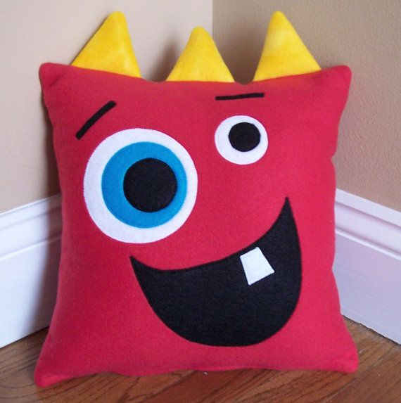 Red Monster/Silly Face Pillow from 3 Silly Monkeys on Etsy.  14x14 pillow made from soft fleece.  $15.00