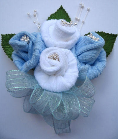 Baby sock corsage to pin on the mother for the baby shower