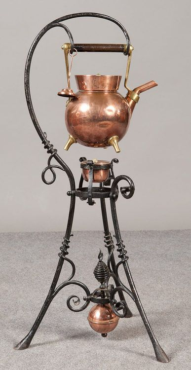 Christopher Dresser designed copper kettle and stand, manufactured by Benham and Froud, 1885.