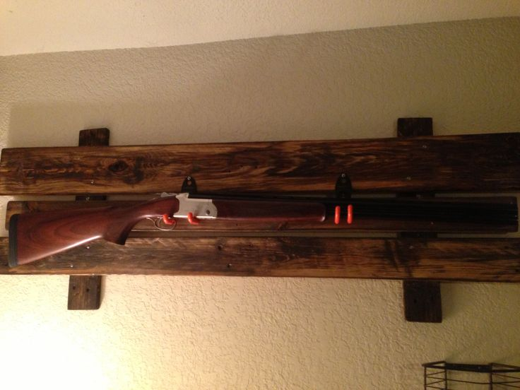 A gun rack I made from a pallet, my first pallet project. I sanded and stained it with natural stain, then ran around the edges with a dark cedar and added the dark in the middle to give it the old rustic look. I used tornado hooks from Home Depot, and I planned on wrapping the hooks in leather so they aren't so orange.
