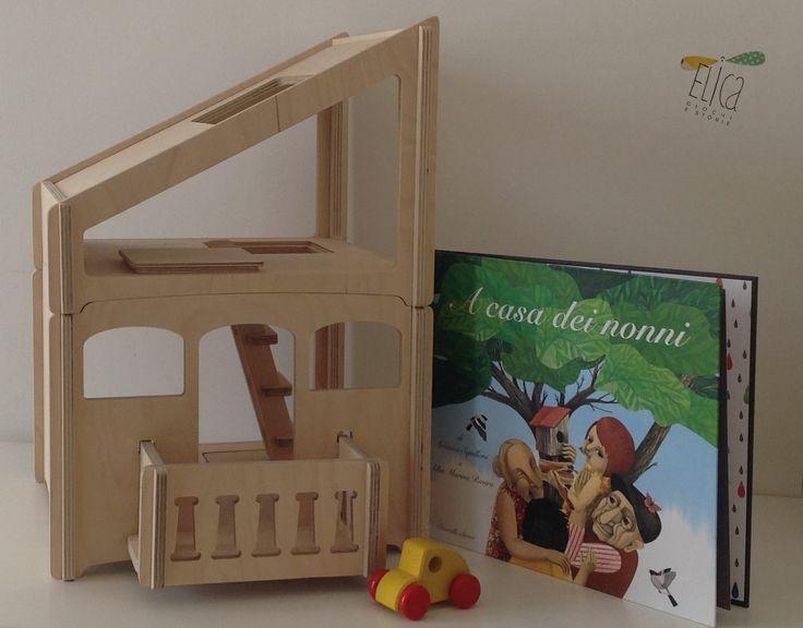 """""""A casa dei nonni"""", di Arianna Squilloni e Alba Marina Rivera, Donzelli editore. Casetta delle bambole in legno con mansarda, DipDap. Piccola macchinina in legno, PW. Libri per bambini. Giocattoli in legno."""