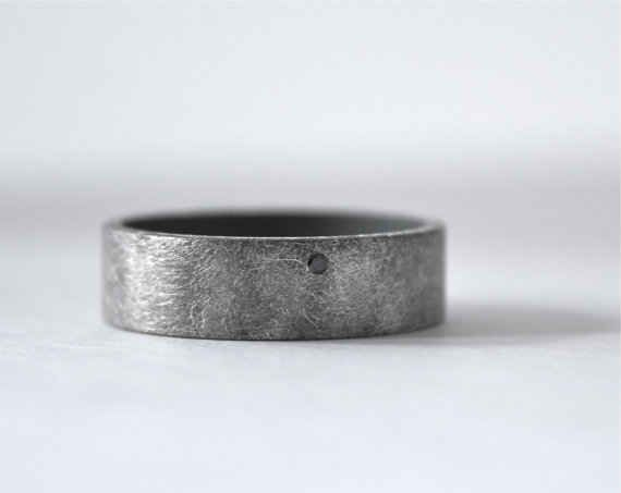 Tiny Black Diamond Band, $170 | 34 Unconventional Wedding Band Options For Men...the coolest ring I have ever seen