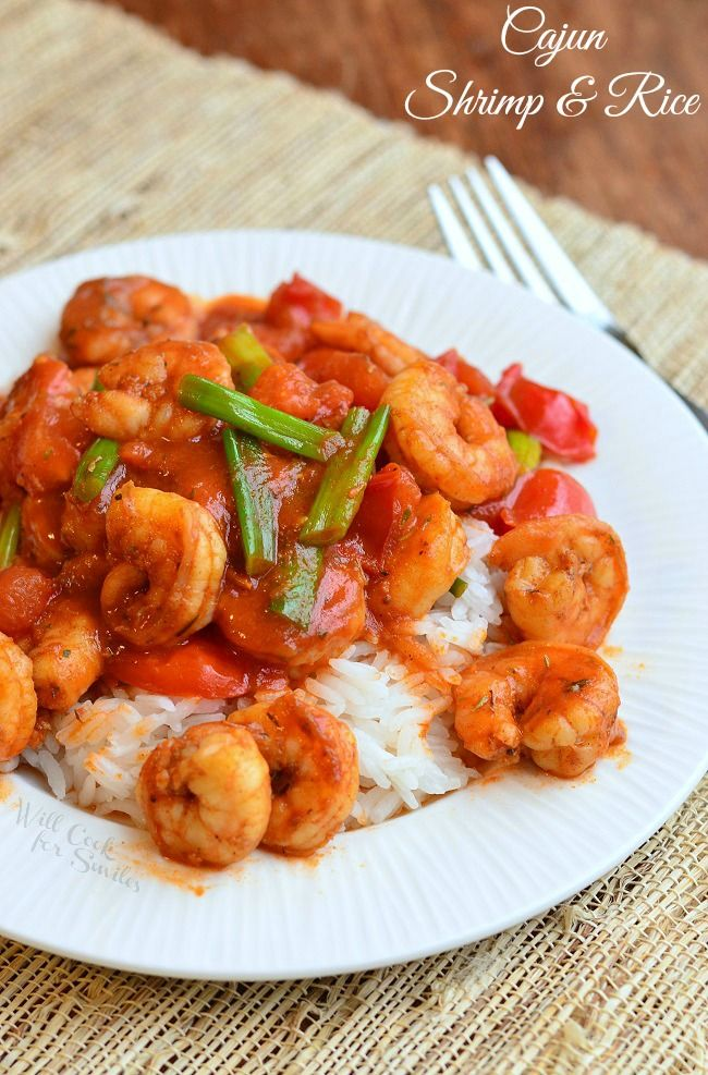 Spicy, spicy delicious dinner! Cajun Shrimp cooked with tomatoes and scallions in spicy tomato sauce and served over rice.