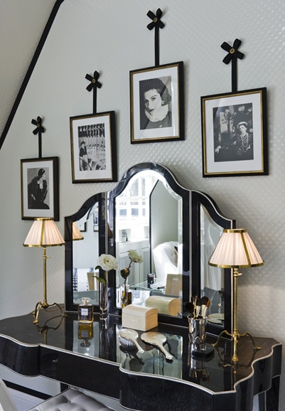 Interesting idea for framed photographs above a dressing table. love this