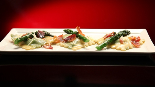 Herb printed ravioli with sage butter sauce, pancetta and asparagus