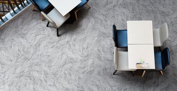 Šedá podlaha z vinylu Expona Commercial, design skládaný papír. / Gray floor from Expona Commercial, folded paper design, BOCA Praha.  http://www.bocapraha.cz/cs/aktualita/80/vinylova-podlaha-jako-zmackany-papir-nebo-rezavy-plech/