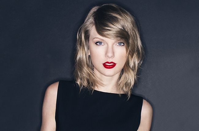 Taylor Swift--Red Lipstick Blonde paired with a powerful little black dress.
