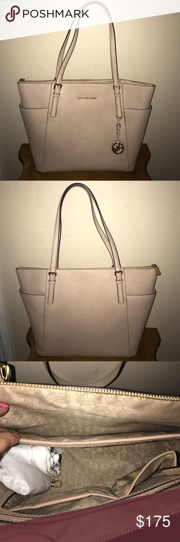 Michael Kors Tote Authentic Michael Kors Zip Top Large Tote. Gently used but looks brand new. Color: Oyster. Includes: Michael Kors dust bag shown in picture. No damage to any of the leather. Multiple storage inside. Comment with any questions! Price negotiable KORS Michael Kors Bags Totes