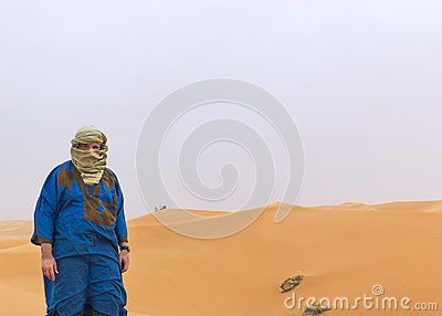 Self-portrait in the Sahara desert in southern Morocco, used as an Avatar. I am dressed in the typical costume of the blue people,  people of the desert.