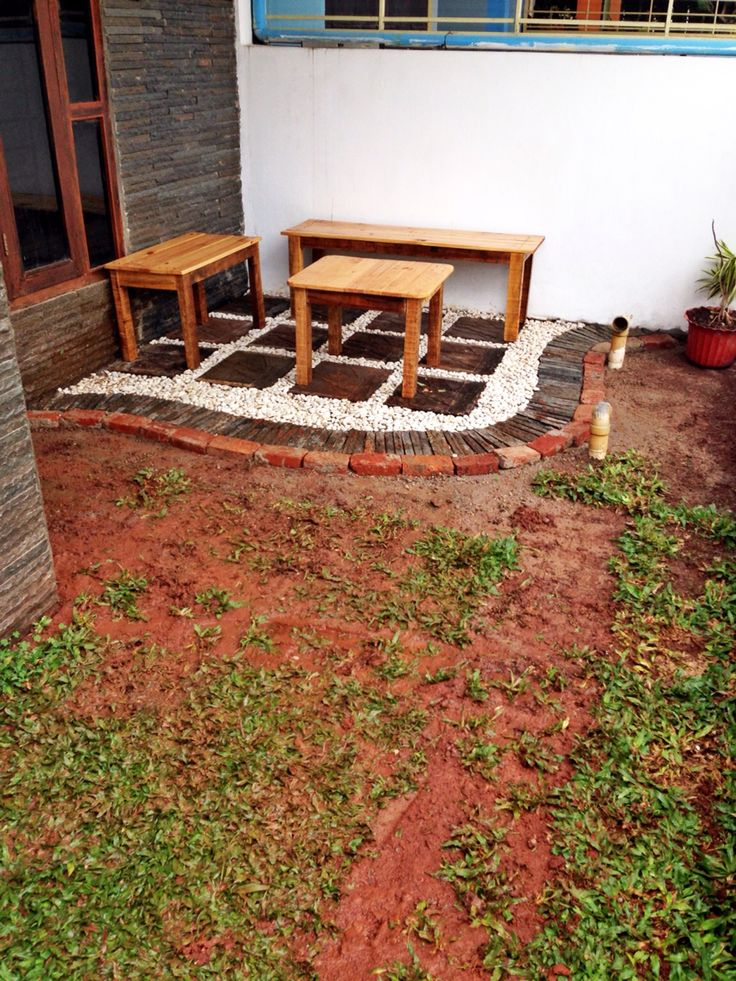 lanscaping using leftover roof tile, sand, brick, and natural stone