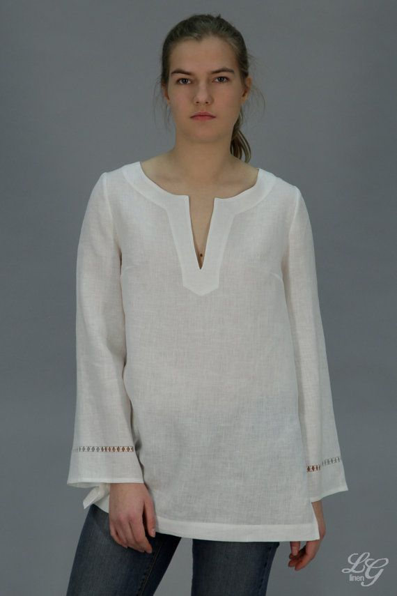 Linen tunic with long and flared sleeves. On sleeves is delicate handmade drawnwork - with tied threads in the middle. At sides- 22cm (8,5) length