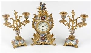 A good early 20th century French brass, bronze and champleve enamel clock garniture