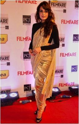 Diya Mirza takes a risk with this bold sari and PANTS. That's right, pants. But it works because she keeps everything else simple and the gold sari adds the right effect.