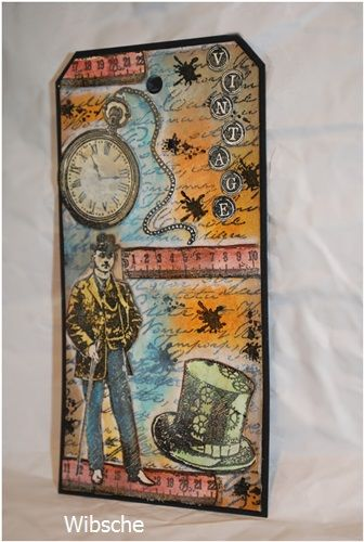 Tag with stamps from viva decor. coloured with distress plus neocolor 2