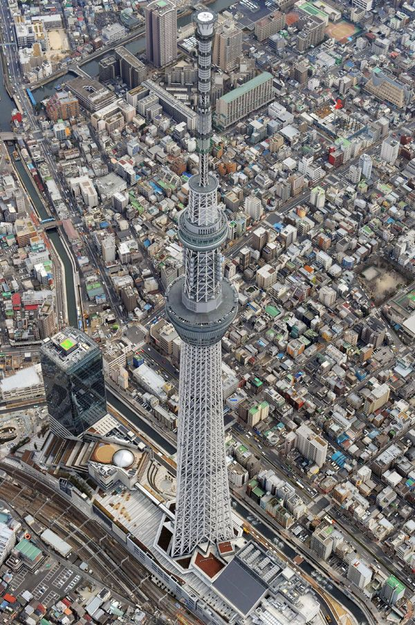 Sky Tree - Tokyo. Supposedly quake proof. 637 meters tall. Has a cylindrical core of reinforced concrete.