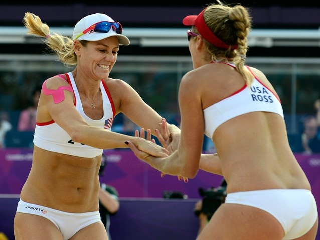 Women Of Beach Volleyball - April Ross (R) and Jennifer Kessy from the US celebrate at the end of the women's Beach Volleyball preliminary phase Pool D match against Spain's Liliana Fernandez and Elsa Baquerizo