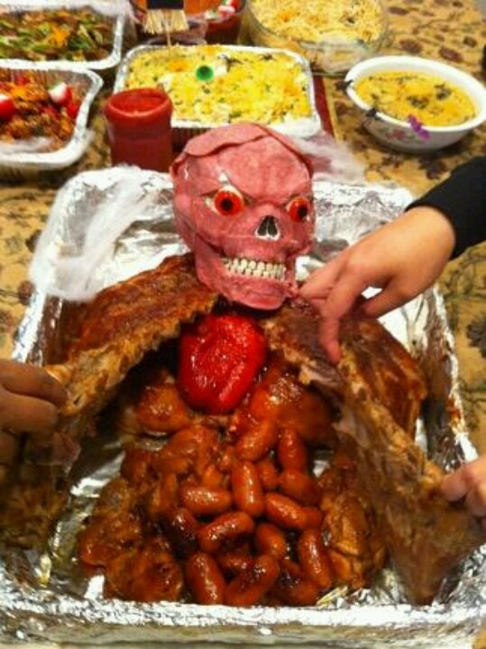 awesome but creepy food idea for halloween it looks like two racks of ribs sausage links chicken wings and a skull covered in some meat slices might do - Halloween Casserole Recipe Ideas