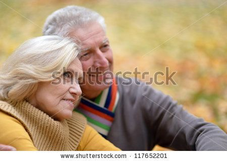 cute older couples | portrait of a cute old couple sitting in autumn park - stock photo