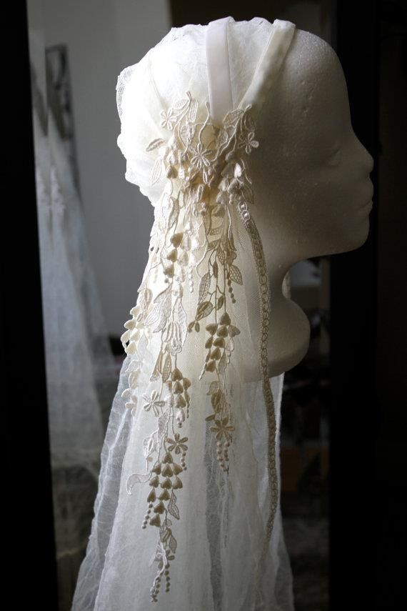 I don't usually do the wedding stuff, but I love this pre-Raphaelite veil.