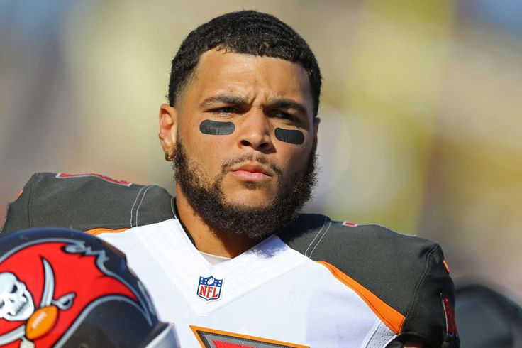 NFL players' national anthem protests   -  Tampa Bay Buccaneers wide receiver Mike Evans sat during the national anthem against the Chicago Bears at Raymond James Stadium to protest President Trump's election.