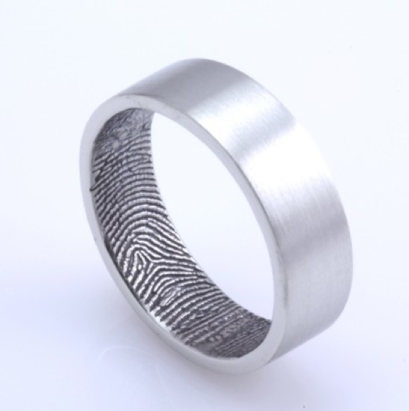 Instead of engraving each others rings, have one-anothers fingerprints etched on the inside