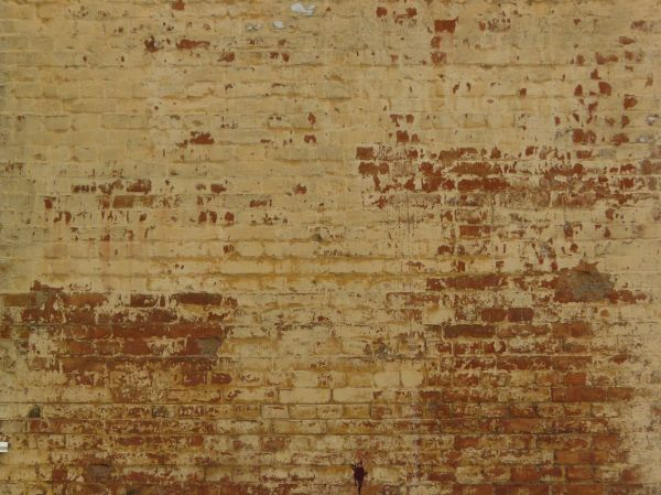 Worn Brick Wall Painted In Red And Beige Tones Projects