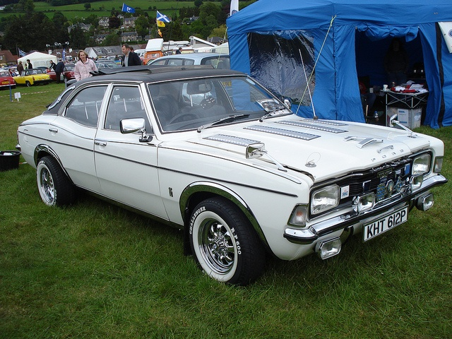 Ford cortina, a bit over the top with the chroming and detailing. But I love the white paint and whitewall tire combo.